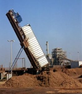 A hydraulic truck unloader in action.
